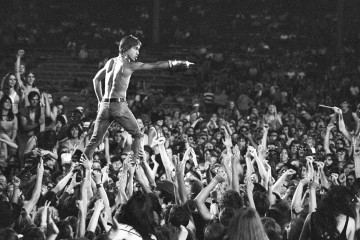 CINCINNATI - JUNE 23: Iggy Pop of the Stooges rides the crowd during a concert at Crosley Field on June 23, 1970 in Cincinnati, Ohio. (Photo by Tom Copi/Michael Ochs Archive/Getty Images)